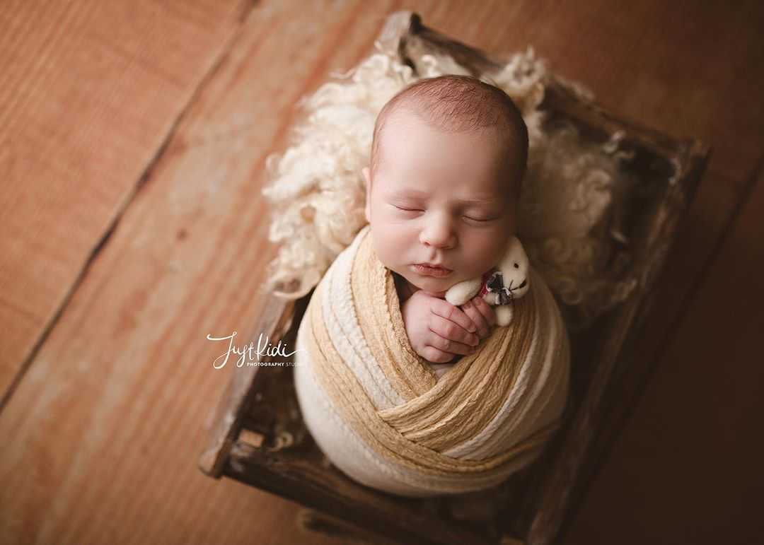 Newborn Photography - With a Toy Pose